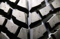 Fim acima da profundidade da superfície do pneumático do terreno da lama de campo rasa Imagens de Stock