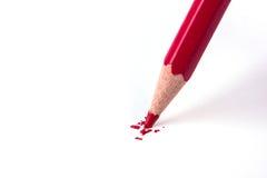 Fim acima da ruptura da cabeça do lápis da cor vermelha Fotografia de Stock Royalty Free