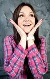 Fim-acima de uma jovem mulher que olha excitada Foto de Stock Royalty Free