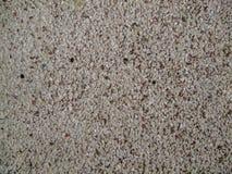 Fim acima do fundo concreto da textura do assoalho do cimento da pedra pequena abstrata horizontal Foco seletivo fotografia de stock