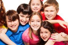 Fim-acima do grupo de miúdos felizes Fotos de Stock Royalty Free