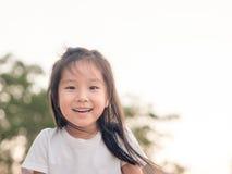 Fim bonito asiático adorável da menina acima do tiro principal Imagem de Stock Royalty Free