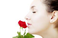 Fim bonito da face da menina acima com uma rosa à disposicão Imagem de Stock
