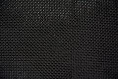 Fim composto da matéria prima da fibra preta do carbono acima Imagens de Stock Royalty Free
