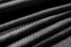 Fim composto da matéria prima da fibra preta do carbono acima Fotografia de Stock
