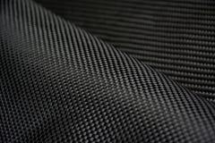 Fim composto da matéria prima da fibra preta do carbono acima Fotos de Stock