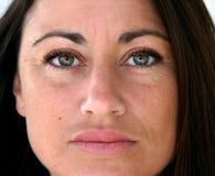 Fim consideravelmente espanhol da face da mulher acima Foto de Stock Royalty Free