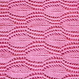 Fim cor-de-rosa tricotado manualmente do teste padrão acima Fotografia de Stock Royalty Free