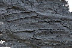 Fim cosmético vulcânico preto da textura da argila acima solução de fundo cosmético do sumário da argila Fotos de Stock Royalty Free