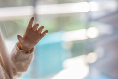 Fim da mão da boneca acima com fundo borrado fotografia de stock royalty free