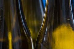 Fim da reflexão das garrafas de vidro acima Fotos de Stock Royalty Free