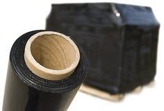 FIM del estiramiento y paleta negras de la caja de cartón Imagen de archivo
