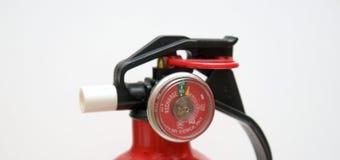 Fim do calibre do extintor de incêndio acima imagens de stock royalty free