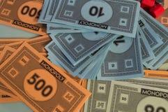 Fim do dinheiro do monopólio acima do detalhe fotografia de stock royalty free