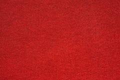 Fim extremal da superfície da tabela de feltro do vermelho acima imagens de stock