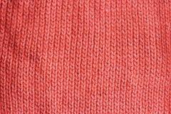 Fim feito malha coral de vida da textura do fundo da cor da tendência acima foto de stock royalty free