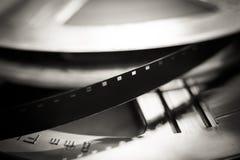 Fim super do macro do carretel de filme de 8 milímetros acima, símbolo do filme Fotografia de Stock Royalty Free