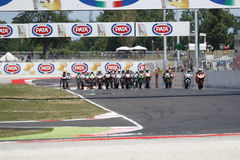 FIM Superbike World Championship - Race 2. Misano Adriatico, Italy - June 21, 2015: Bikes prepare to leave the grid at the start during race one at the Misano Royalty Free Stock Image