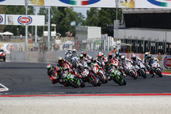 FIM Superbike World Championship - Race 2. Misano Adriatico, Italy - June 21, 2015: Bikes prepare to leave the grid at the start during race one at the Misano Royalty Free Stock Photo