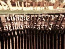 Fim velho do macro das letras da máquina de escrever do vintage acima Fotografia de Stock Royalty Free