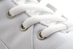 Fin blanche de chaussure vers le haut Photographie stock