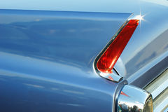 Fin of a classic caddy. Rear section with tail light of  luxurious retro transportation. A Stock Photography