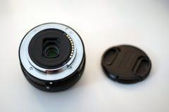 Fin d'arrière de chapeau d'objectif de caméra et de couverture  Photographie stock