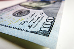 Fin de billet de banque de 100 USD vers le haut de la photographie Photographie stock libre de droits