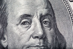 Fin de macro du visage de Ben Franklin  Image libre de droits