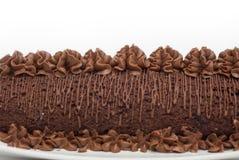 Fin faite maison de gâteau de chocolat d'isolement sur le fond blanc Photographie stock