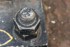 Fin industrielle noire de boulon  Photo libre de droits