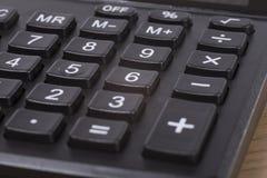 Fin noire de clavier numérique de nombre de calculatrice  Photographie stock