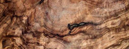 Fin texturisée brune en bois olive de conseil sur le fond noir vi Images stock