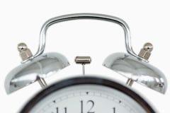 Fin vers le haut d'une horloge d'alarme démodée Photographie stock