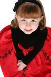Fin vers le haut de petite fille mignonne dans la robe de vacances images libres de droits