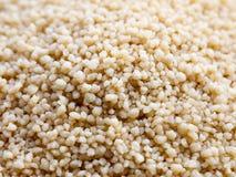 fin vers le haut de texture du macro cous cous de céréales délicieux photos stock