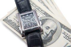 Fin vers le haut, temps et argent. Photographie stock