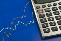 Finacial Growth. Closeup image of finacial graph and calculator royalty free stock photography