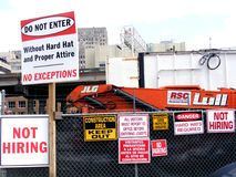 Finacial-Jobs-Not Hiring Signs at Construction Site Royalty Free Stock Photography