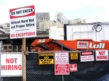 Finacial-Jobs-Not Hiring Signs at Construction Site. Social-Inner City-Finacial-Jobs-Not Hiring Signs at Construction Work Site Royalty Free Stock Photography