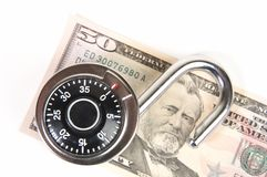 Finacial Security. A dial type padlock on an American fifty dollar bill royalty free stock photos