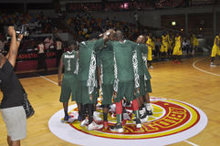 FINAL OF AFRO BASKET. The Nigerian national team motivated through war cries before the start of the final of the African basketball held in Ivory Coast Royalty Free Stock Photo