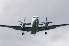 Final Approach. A Beechcraft 1900D in landing configuration on final approach Royalty Free Stock Photos