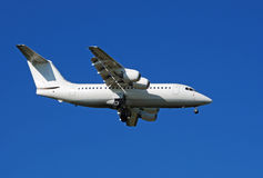 Final approach. A white plane in final approach royalty free stock photos