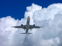 Final Approach. A Jet Airliner On Final Approach, Wheels Down. Dramatic Clouds In Background stock image