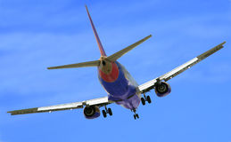 Final Approach. Jetliner makes its turn to final approach Royalty Free Stock Photography