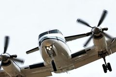 Final approach. A close up of a twin engine aircraft on final approach stock photo