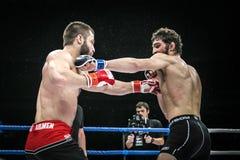 Final battle MMA fighters kick hand Stock Image