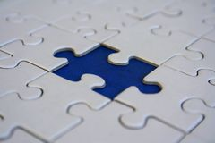 Final blue jigsaw piece Royalty Free Stock Image