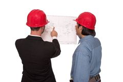 Final check. Architect looking over blueprints with foreman Royalty Free Stock Photos